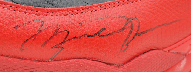 This undated image provided by Grey Flannel Auctions shows Michael Jordan's autographed shoes from the famous flu game of the 1997 NBA Finals. The Nike shoes sold on an online auction Thursday Dec ...