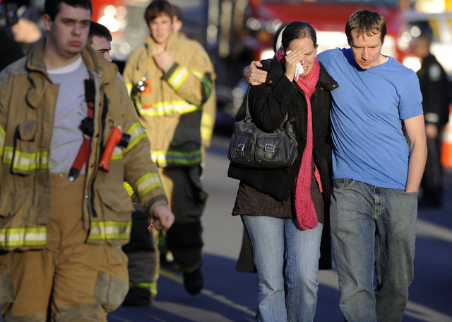 In this Dec. 14, 2012 file photo, Robert and Alissa Parker, at right, leave a firehouse staging area following a shooting at the Sandy Hook Elementary School in Newtown, Conn. Gunman Adam Lanza op ...