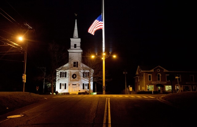 In this Dec. 15, 2012 file photo, a U.S. flag flies at half-staff on Main Street in honor of the 26 people killed when gunman Adam Lanza opened fire inside a Sandy Hook Elementary School on Dec. 1 ...