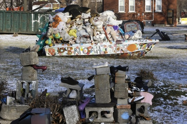 In a photo from Tuesday, Dec. 10, 2013 an art installation is seen at the Heidelberg Project in Detroit. There have been at least eight fires since early May leading to questions about who might b ...
