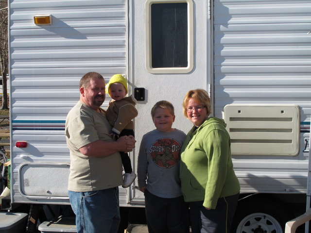 The Dale family stands outside their 24-foot-long camper at a campground on Dec. 12, 2013, outside Campbellsville, Ky. The family is among the throngs of people who converge on area campgrounds, l ...