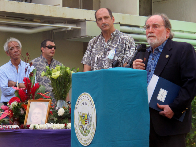 Hawaii Gov. Neil Abercrombie, right, speaks at a gathering in memory of state Health Department Director Loretta Fuddy, as Deputy Director Gary Gill, second from right, listens in Honolulu on Thur ...