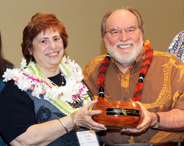 CLARIFIES CAPTION - In this March 21, 2013 photo provided by the Hawaii governor's office, state Health Department Director Loretta Fuddy, left, and Gov. Neil Abercrombie pose for a photo. Fuddy w ...