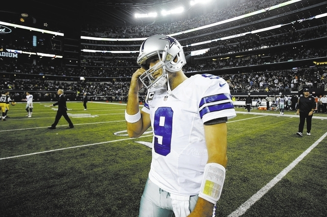 Dallas Cowboys quarterback Tony Romowalks off the field after the 37-36 loss to the Green Bay Packers after an NFL football game Sunday, Dec. 15, 2013, in Arlington, Texas. Romo threw two intercep ...