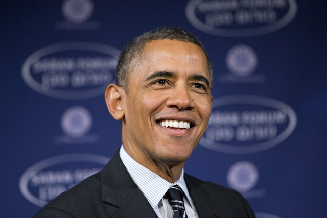 In this Dec. 7, 2013 file photo, President Barack Obama smiles as he arrives at the  Saban Forum to speak about the Middle East at the Willard Hotel in Washington.  (AP Photo/Jacquelyn Martin)