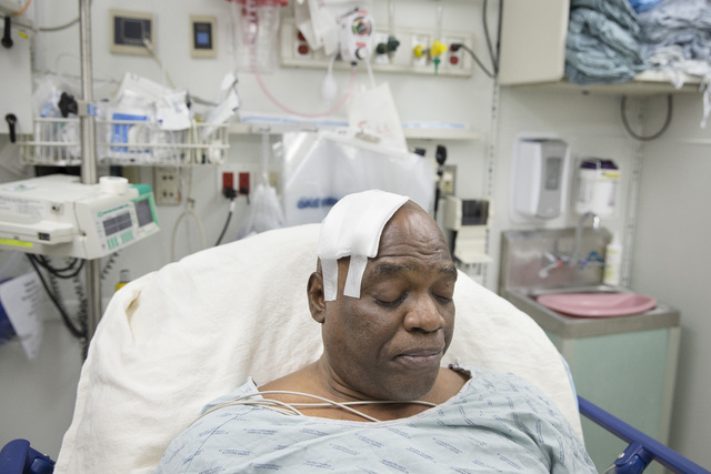 Cecil Williams rests in his hospital bed following a fall onto subway tracks from the platform at 145th Street, Tuesday, Dec. 17, 2013, in New York. Williams, 61 and blind, says he fainted while h ...
