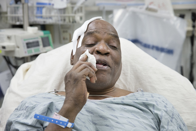 Cecil Williams wipes tears from his face during an interview as he rests in his hospital bed following a fall onto subway tracks from the platform at 145th Street, Tuesday, Dec. 17, 2013, in New Y ...
