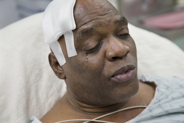 Cecil Williams cries during an interview as he rests in his hospital bed following a fall onto subway tracks from the platform at 145th Street, Tuesday, Dec. 17, 2013, in New York. Williams, 61 an ...
