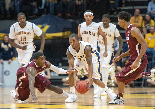 In this Dec. 17, 2013 photo, Murray State's T.J. Sapp (22), center right, grabs a loose ball as South Illnois' Anthony Beane falls during an NCAA college basketball game in Murray, Ky. Southern Il ...