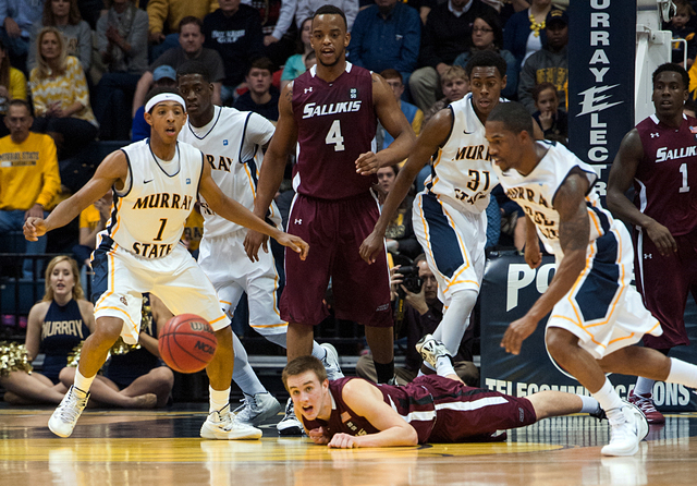 In this Dec. 17, 2013 photo, Murray State's Cameron Payne (1) and T.J. Sapp (22), right, chase a loose ball as South Illnois' Anthony Beane falls during an NCAA college basketball game in Murray,  ...