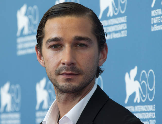 In the Sept. 6, 2012, file photo, actor Shia LaBeouf poses at the 69th edition of the Venice Film Festival in Venice, Italy. LaBeouf debuted his short film, Howard Cantour.com, online on Monday, D ...