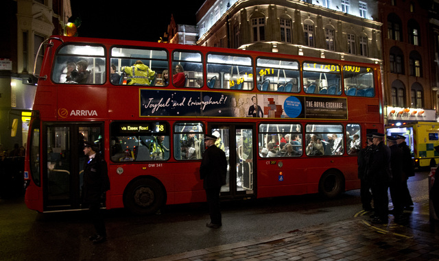 Shocked and injured theatergoers are transported to hospital in a commandeered London bus  following an incident  during a performance at the Apollo Theatre,  in London's Shaftesbury Avenue, Thurs ...