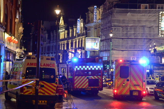 Emergency services attend the scene at the Apollo Theatre in Shaftesbury Avenue, central London, Thursday, Dec. 19, 2013. A theater in central London partially collapsed Thursday night during a pe ...