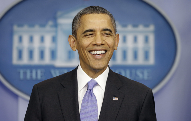 President Barack Obama smiles as he prepares to answer a question during an end-of-the year news conference in the Brady Press Briefing Room at the White House in Washington, Friday, Dec. 20, 2013 ...