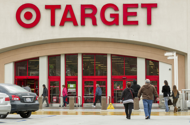 Shoppers arrive at a Target store in Los Angeles on Thursday, Dec. 19, 2013. Target says that about 40 million credit and debit card accounts may have been affected by a data breach that occurred  ...