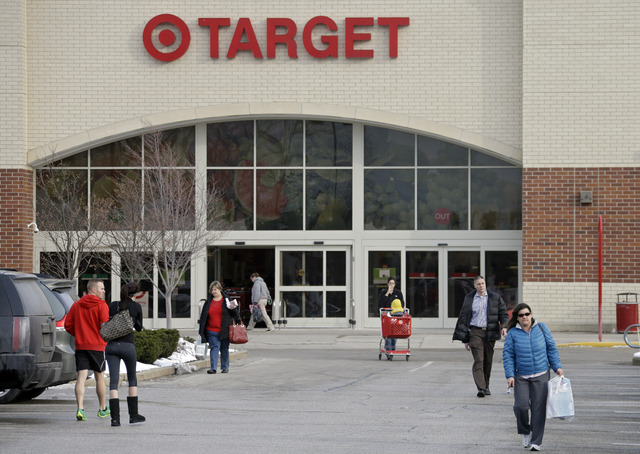 Shoppers leave a Target store in North Olmsted, Ohio Thursday, Dec. 19, 2013. Target says that about 40 million credit and debit card accounts may have been affected by a data breach that occurred ...
