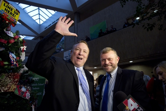 Utah State Sen. Jim Dabakis, left, and his husband, Stephen Justesen, acknowledge the crowd after being married in the lobby of the Salt Lake County Clerk's Office in Salt Lake City on Friday, Dec ...