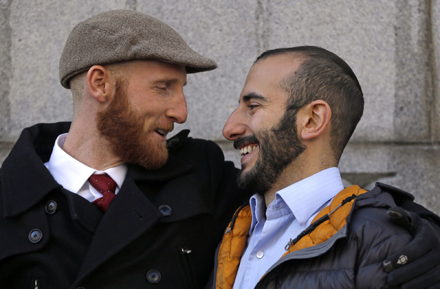 In this Dec. 4, 2013 file photo, Derek Kitchen, left, and his partner Moudi Sbeity look at each other following court in Salt Lake City. A challenge to Utah's same-sex marriage ban by three gay co ...