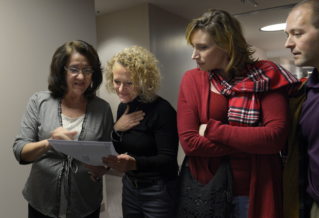 Former Utah State Rep. Jackie Biskupski, second from left, a longtime gay rights supporter, looks at the marriage license held by Wany Morrison, left, Friday, Dec. 20, 2013, in Salt Lake City. Mor ...