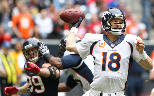 Denver Broncos quarterback Peyton Manning (18) drops back to pass during the first half of an NFL football game against the Houston Texans, Sunday, Dec. 22, 2013, in Houston. (AP Photo/The Courier ...