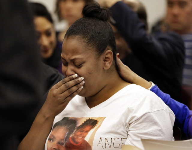Nailah Winkfield, mother of 13-year-old Jahi McMath, cries before a courtroom hearing regarding McMath, Friday, Dec. 20, 2013, in Oakland, Calif. McMath remains on life support at Children's Hospi ...