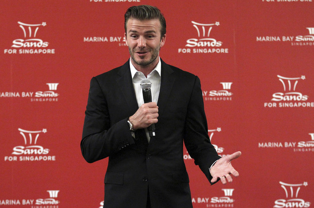 In this July 7 file photo, former soccer star David Beckham greets media and youth in Singapore at the Marina Bay Sands. Beckham has signed on to help promote Las Vegas Sands' properties in Singap ...