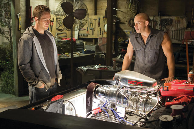 "In this film publicity still released by Universal Pictures, Paul Walker, left, and Vin Diesel, are shown in a scene from ""Fast & Furious."" Universal Pictures has delayed the release of  ..."