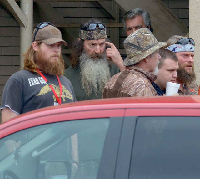 """Phil Robertson, the patriarch of the """"Duck Dynasty"""" TV series, center, leaves the White's Ferry Road Church of Christ in West Monroe, La. on Sunday, Dec. 22, 2013. Robertson was suspende ..."""