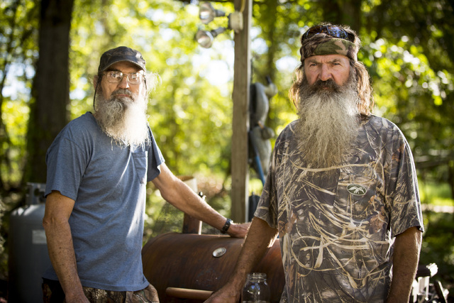 """This undated image released by A&E shows brothers Silas """"Uncle Si"""" Robertson, left, and Phil Robertson from the popular series """"Duck Dynasty."""" Phil Robertson was suspended last ..."""