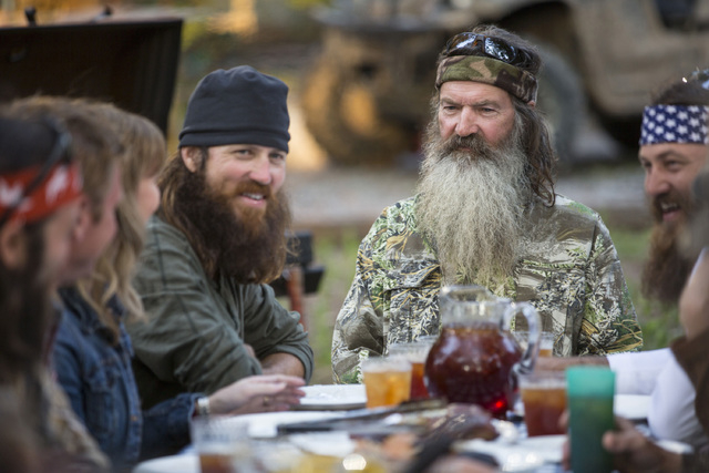 """This undated image released by A&E shows Phil Robertson, flanked by his sons Jase Robertson, left, and Willie Robertson from the popular series """"Duck Dynasty.""""   Phil Robertson was suspe ..."""