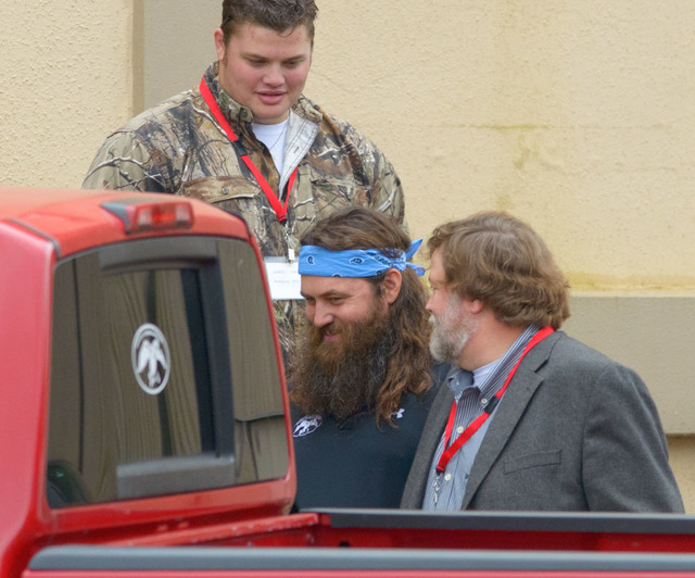 """Wille Robertson, center, star of the TV series """"Duck Dynasty"""" leaves the White's Ferry Road Church of Christ, in West Monroe, La. Sunday, Dec. 22, 2013. Willie's father Phil, the patriar ..."""