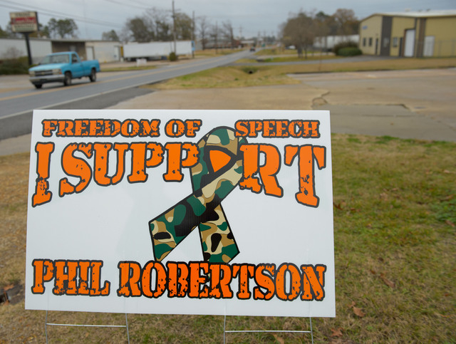 """This Dec. 21, 2013 photo shows a sign in West Monroe, La., supporting Phil Robertson, the patriarch of the popular """"Duck Dynasty"""" series. Robertson was suspended last week for disparagin ..."""