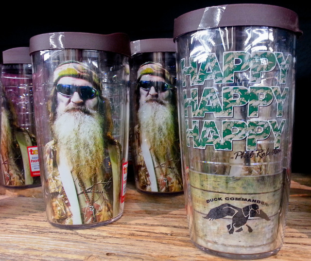 """This Saturday, Dec. 21, 2013 photo shows items showing the image of Phil Robertson and his catchphrase """"Happy, Happy, Happy"""" displayed at the Duck Commander store in West Monroe, La. The ..."""