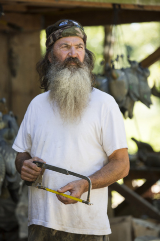 """This undated image released by A&E shows Phil Robertson from the popular series """"Duck Dynasty."""" Robertson was suspended last week for disparaging comments he made to GQ magazine about ga ..."""