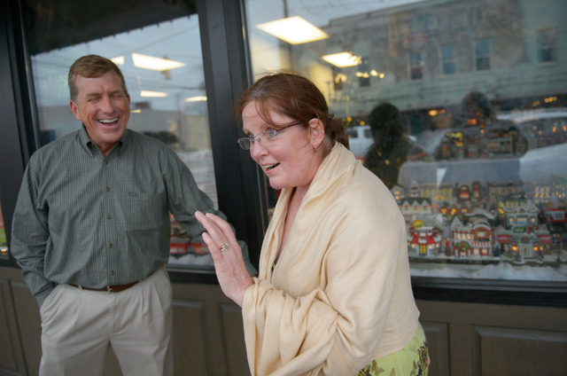 """This Dec. 21, 2013 photo shows The Gingerbread House owner Mike Walsworth, left, laughing at a joke by Marilyn Lovett, 57, about the """"Duck Dynasty"""" controversy in West Monroe, La. The to ..."""