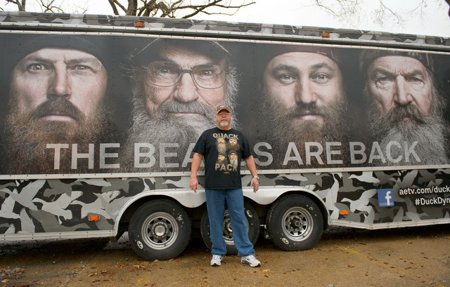 """Howell Henderson of Joplin, Mo., poses for a picture outside the Duck Commander store in West Monroe, La. Saturday, Dec. 21, 2013. The town is the setting for the popular """"Duck Dynasty""""s ..."""