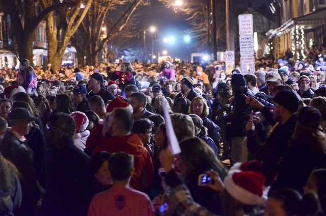 """People fill the 400 block of Chestnut Street, Saturday, Dec. 21, 2013, in West Reading, Pa., where thousands of people came out to sing Christmas carols in front of the home of Delaney """"Laney ..."""