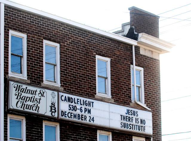 The sign at Walnut Street Baptist Church hangs on the side of the church building at the intersection of Illinois 13 and U.S. 51, one of the busiest intersections in town, making it highly visible ...
