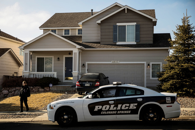 A Colorado Springs Police vehicle is seen parked outside of a house where a 14-year-old girl was mistakenly shot by her stepfather at their home in northeast Colorado Springs, Colorado on Monday,  ...