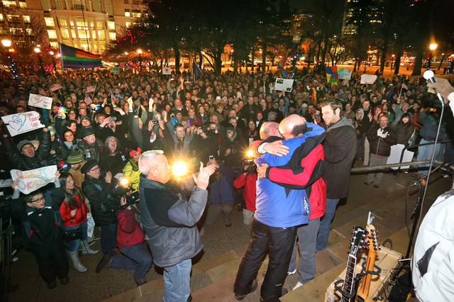 Dan Trujillo, left, and Clyde Peck get married as about 1,500 people gather to show support of marriage equality after a federal judge declined to stay his ruling that legalized same-sex marriage  ...