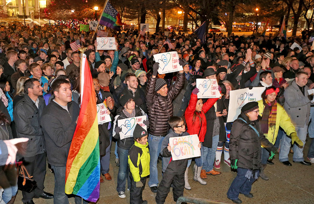 About 1,500 people gather to celebrate marriage equality after a federal judge declined to stay his ruling that legalized same-sex marriage in Utah, at Washington Square just outside of the Salt L ...