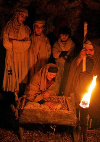 FILE - In this Saturday, Dec. 22, 2007 file photo, Tara Kreider, left, of Harrisonburg, Va., portraying Mary, and Israeli Arab Christian Samir Hawa, right, as Joseph, take part in a Nativity scene ...