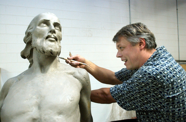 """FILE - In this Sept. 15, 2005 file photo, Sergei Mitrofanov of Livonia, Mich., works on a clay sculpture titled """"Resurrection of Jesus Christ"""" in his studio in Waterford Township, Mich., ..."""