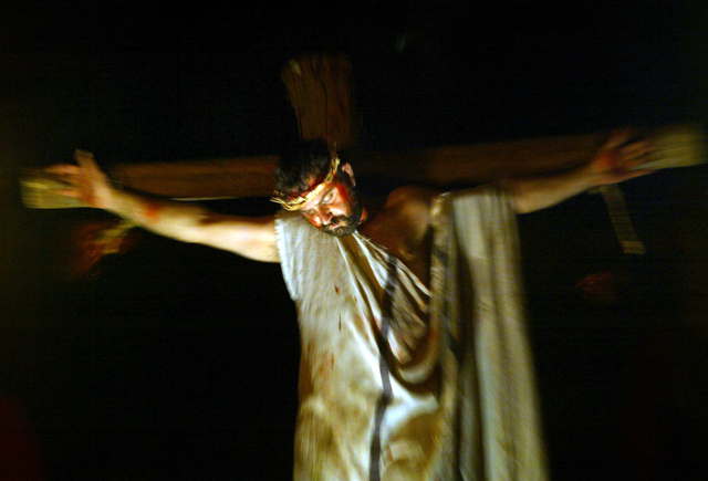 """FILE - In this Wednesday, April 7, 2004 file photo, Samir Hawa, 33, an Israeli Arab Christian, wears a crown of thorns as he re-enacts Jesus Christ's crucifixion in """"Nazareth Village,"""" a ..."""