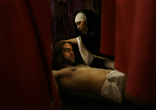 FILE - In this Friday, April 6, 2007 file photo, people portraying Roman soldiers surround the Virgin Mary, played by Carmen Espinosa, tending to Jesus Christ, played by Rafael Gonzalez, after he  ...