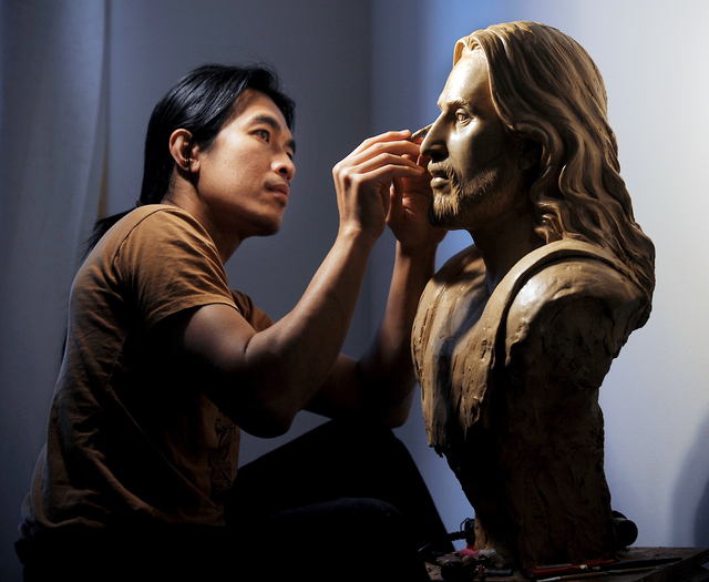 FILE - In this Nov. 20, 2011 file photo, Sunti Pichetchaiyakul of Bigfork, Mont., works in his studio on a wax sculpture of Jesus Christ based on the Shroud of Turin. The finished bronze is displa ...