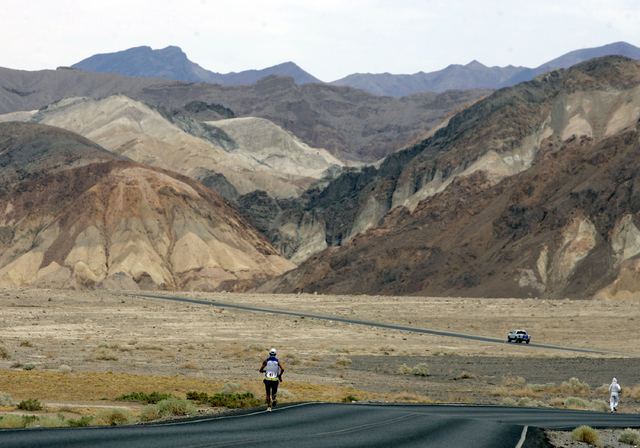 In this July 23, 2007, file photo, Valmir Nunes, of Brazil, runs in Kiehl's Badwater Ultramarathon in Death Valley, Calif. The race start line was at Badwater, Death Valley, which marks the lowest ...