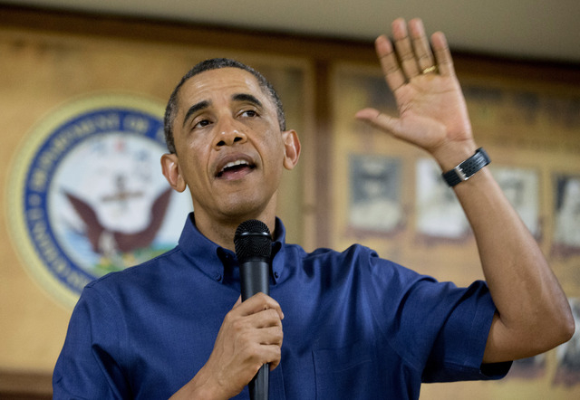 President Barack Obama speaks to members of the military and their families in Anderson Hall at Marine Corps Base Hawaii, Wednesday, Dec. 25, 2013, in Kaneohe Bay, Hawaii. The first family is in H ...