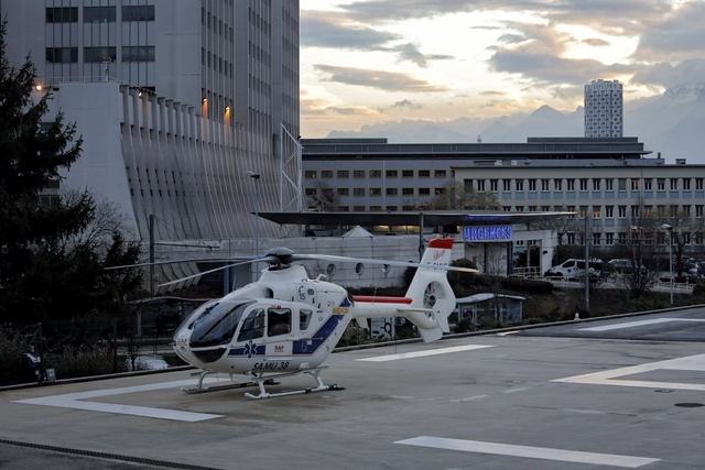 An helicopter is seen in front of the Grenoble hospital, in the French Alps, where former seven-time Formula One champion Michael Schumacher is treated after he sustained a head injury during a sk ...