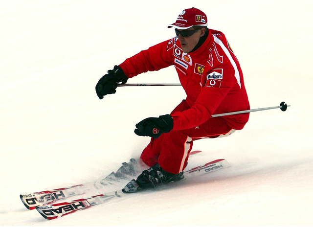 In this Thursday, Jan. 12, 2006 file photo provided by the Ferrari press office, Formula One driver Michael Schumacher of Germany speeds down a course in the Madonna di Campiglio ski resort, in th ...